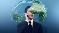 Businessman on the phone surrounded by 3D earth globe video