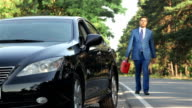 Businessman on the road with a jerrycan video