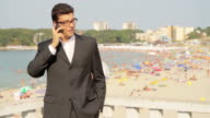 Businessman on Vacation Talking Phone Work Relaxation Concept video