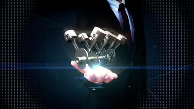 Businessman open palm, Automobile Technology. Engine piston side view. video