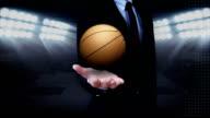 Businessman open palm, basketball. video