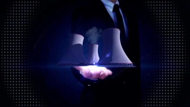 Businessman open palm, Smoked cooling tower of nuclear power plant, thermal power plant video