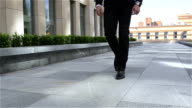 businessman out of the building, slow motion video