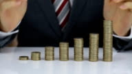 Businessman Protecting Coins Stack On Desk video