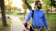 Businessman Pushing Bicycle and going home late video