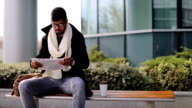 Businessman reading newspaper on coffee break video