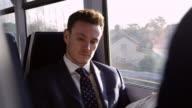 Businessman Reading Newspaper On Train Shot On R3D video