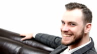 Businessman relaxed sitting down in a sofa video