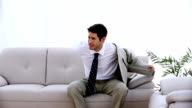 Businessman relaxing in his sitting room video