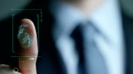 businessman scan fingerprint biometric identity and approval. concept of the future of security and password control through fingerprints in an immersive technology future and cybernetic, business video