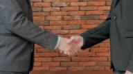 Businessman shaking hands video