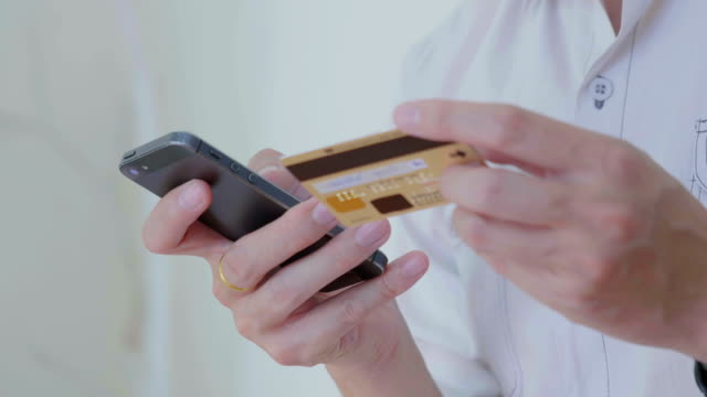 Businessman shopping online on Mobile phone,Close-up video