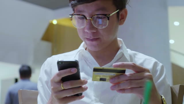 Businessman shopping online on smart phone video