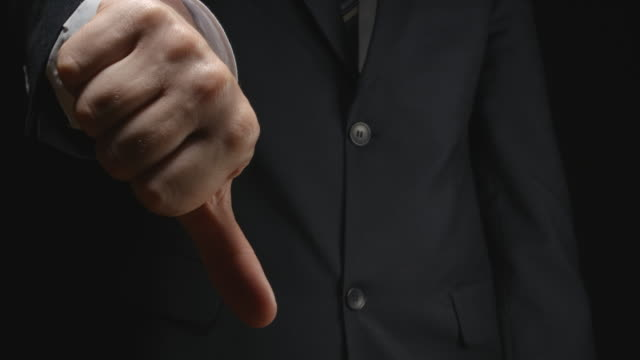 Businessman show a gestures: dislike video