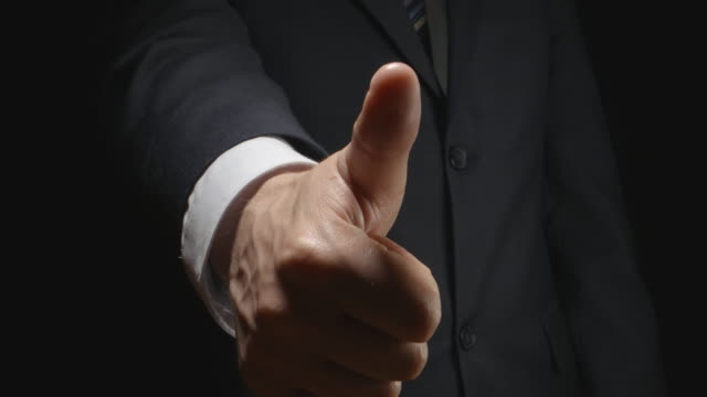 Businessman show the gestures by hands: one like and two likes video
