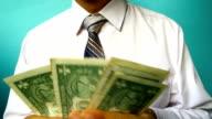 businessman show US dollar banknote video