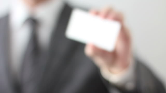 Businessman showing blank business card video