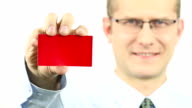 Businessman showing red business card video