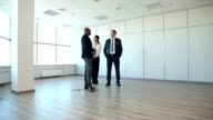 Businessman Shows the Customer a New Office Space video