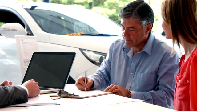 Businessman siging some documents video