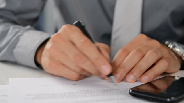 Businessman signing a contract video