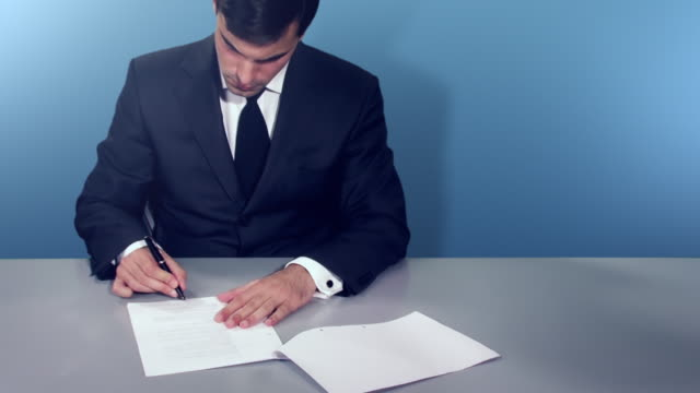 Businessman signing a contract with 3D graph video