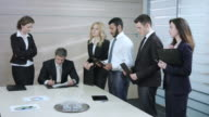 Businessman signs a contracts. video