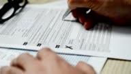 Businessman signs tax form 1040 video