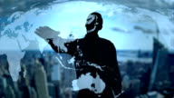 Businessman silhouette using holographic earth map interface technology - Loop video