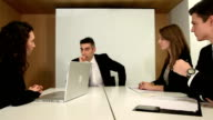 Businessman smiles at camera during meeting video