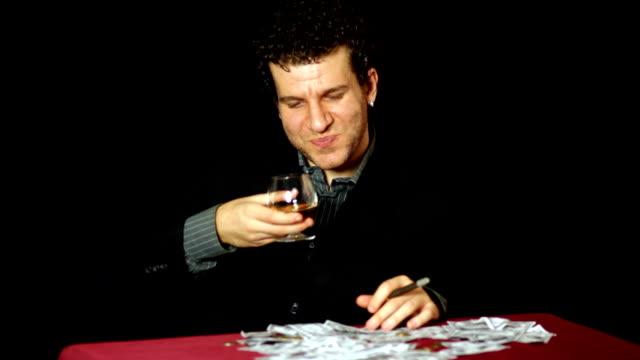 Businessman smoking and drinking video