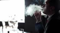 Businessman smoking cigar video