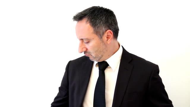 Businessman sniffs smell of money video