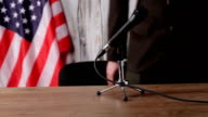 Businessman speaking into the microphone. video