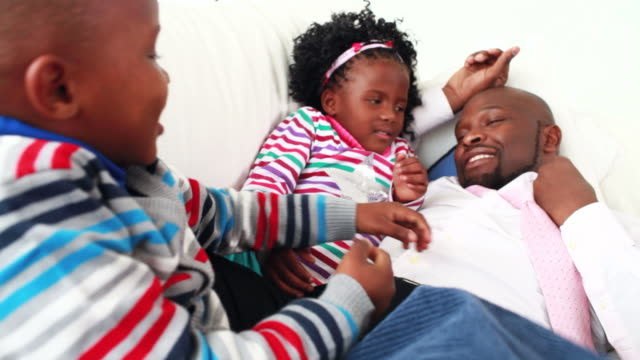 Businessman spending time with his children video