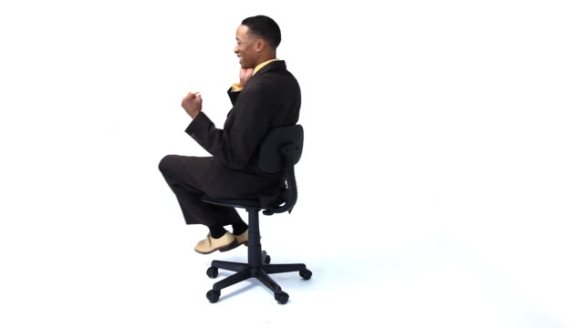 Businessman spinning in chair video