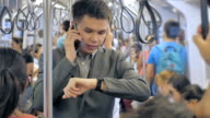 Businessman standing and using smartphone on a train video