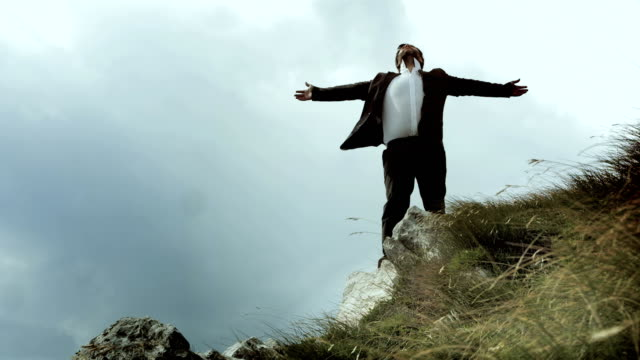 HD: Businessman Standing On The Cliff video