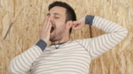 Businessman stretching and yawning in office video