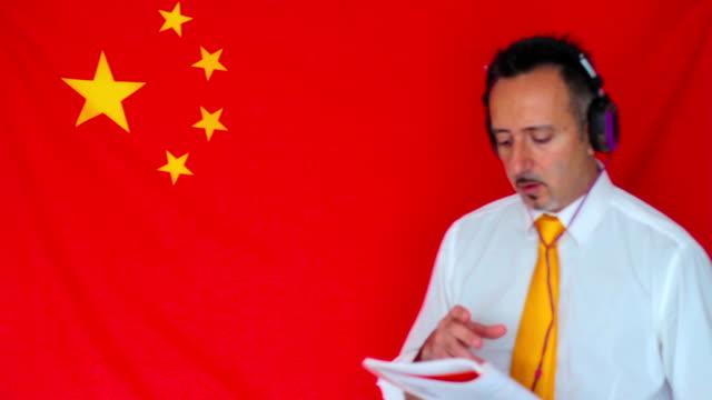 Businessman studying chinese language video