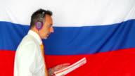 Businessman studying russian language video