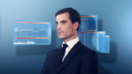 Businessman surrounded by spinning financial graphs video