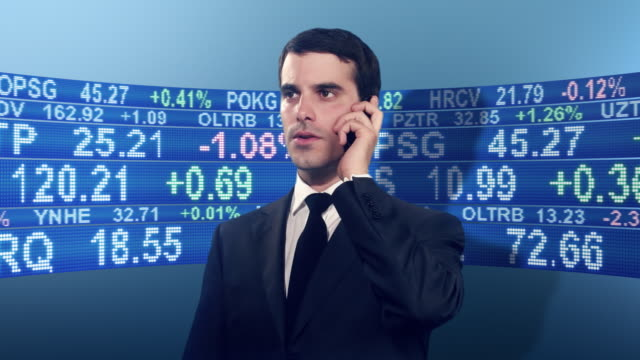 Businessman surrounded by stock market tickers video