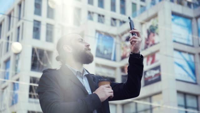 Businessman taking a selfie shot video