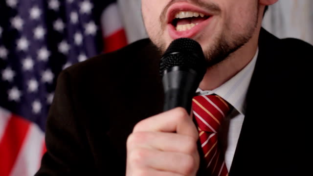 Businessman talking into the microphone. video