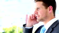 Businessman talking on his mobile phone video