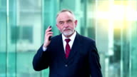 Businessman talking on mobile phone, HD movie (1920X1080, 25fps) video