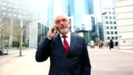 Businessman talking on mobile phone in financial district, HD movie (1920X1080, 25 fps) video