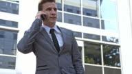 Businessman talking on mobile phone video