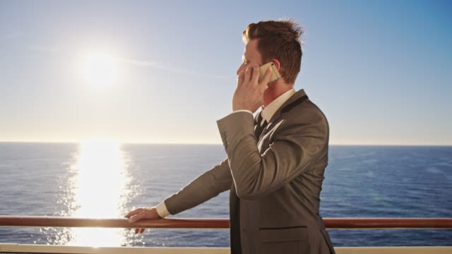 Businessman talking on the phone on a ship video